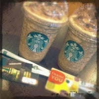 Photo taken at Starbucks by Eva Y. on 5/2/2012