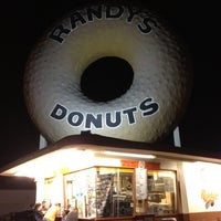 Photo taken at Randy's Donuts by Steven B. on 8/10/2012