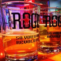 Photo taken at Rogue Ales Public House & Brewery by Shana R. on 5/28/2012