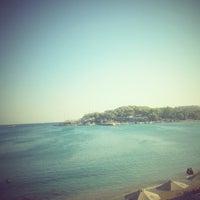 Photo taken at Vouliagmeni Beach by soo_faki on 8/18/2012