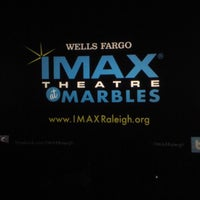 Photo taken at Wells Fargo IMAX Theatre at Marbles by Austin L. on 7/23/2012