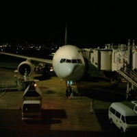 Photo taken at Gate 11 by Yasuaki N. on 2/16/2012