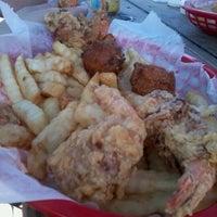 Photo taken at Dewey Destin's Seafood & Restaurant by Heidi on 4/1/2012