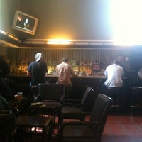 Photo taken at Traxx Bar by Danielle W. on 3/30/2012