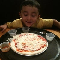 Photo taken at diVine Pizza by Katie A. on 10/14/2011