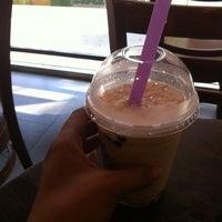 Photo taken at Roastown Coffee by amrita r. on 7/23/2011