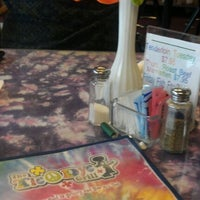 Photo taken at Tie Dye Grill by Chris T. on 12/23/2011