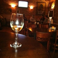 Photo taken at Grinds & Wines by Judy F. on 10/2/2011