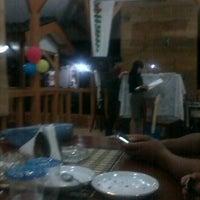Photo taken at Panglawungan Bumi Pasundan Cottages by Disty Z. on 12/17/2011