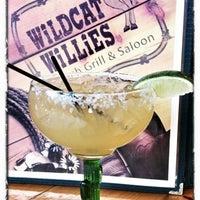 Photo taken at Wildcat Willie's Ranch Grill & Saloon by Marketa on 6/18/2012