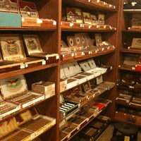 Photo taken at Humidour Cigar Shoppe by Nathalia C. on 11/6/2011