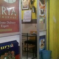 Photo taken at Surya Restaurant by Plato P. on 4/23/2012