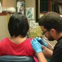 Photo taken at Lark Tattoo by Laura M. on 9/7/2011