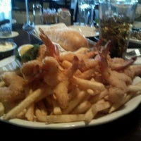 Photo taken at Pappadeaux Seafood Kitchen by Tosha D. on 12/29/2011