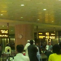 Photo taken at International Arrivals at KFIA by Farouq A. on 3/10/2012