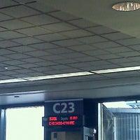 Photo taken at Gate C23 by Myrna P. on 3/10/2012