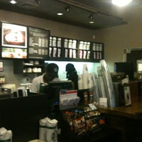 Photo taken at Starbucks by Tatiana C. on 4/11/2012