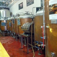 Photo taken at Defiant Brewing Co. by Andrew H. on 5/27/2012