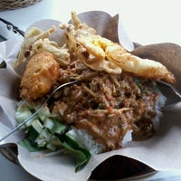 Photo taken at Nasi Pecel Cak Awie by Ahmad Rifa'i (. on 1/15/2012