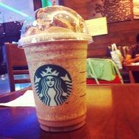 Photo taken at Starbucks by Ning I. on 7/22/2012