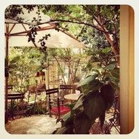 Photo taken at Flores na Varanda by Mariana N. on 2/25/2012