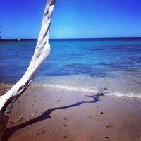 Photo taken at Waialea Bay by Julie G. on 5/9/2012