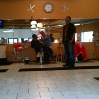 Photo taken at Lifestyles Barber and Sneaker Shop by JL J. on 12/14/2011