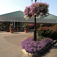 Photo taken at Hicks Nurseries by John R. on 7/12/2012