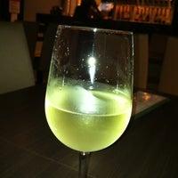Photo taken at Aloha Wine Bar by Markus K. on 1/22/2012