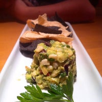 Photo taken at California Pizza Kitchen by Nancy H. on 4/22/2012