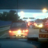 Photo taken at Kesas Exit 511B to Puchong by Amran N. on 1/19/2012
