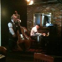 Photo taken at Jazmo'z Bourbon St. Cafe by Alysia L. on 7/31/2011