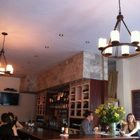 Photo taken at The Tangled Vine Wine Bar & Kitchen by Jenny S. on 8/23/2011