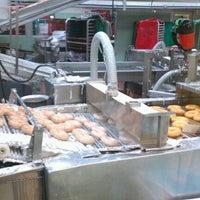 Photo taken at Krispy Kreme Doughnuts by Tanya S. on 12/17/2011