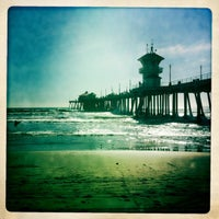 Photo taken at Huntington Beach Pier by Jaime M. on 3/16/2011