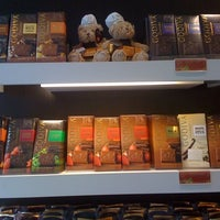 Photo taken at Godiva Chocolatier by Malia H. on 1/1/2011