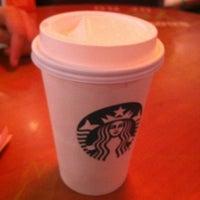 Photo taken at Starbucks Coffee by Lenin C. on 7/9/2012