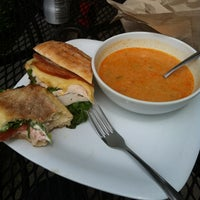 Photo taken at L'Artisan Cafe and Bakery by Chris on 6/26/2012