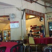 Photo taken at Restaurant Mualaf by Lynda N. on 12/23/2011