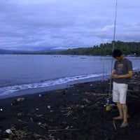 Photo taken at Pantai Kambiow by No'fLy S. on 1/25/2012