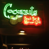 Photo taken at Coconuts Beach Bar and Mexican Grill by Edwin G. on 8/18/2012