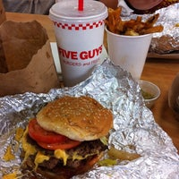 Photo taken at Five Guys by Jenna H. on 7/14/2011