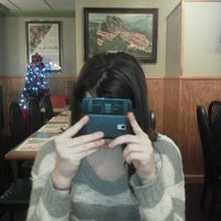 Photo taken at Moonlite Café by David F. on 12/18/2011