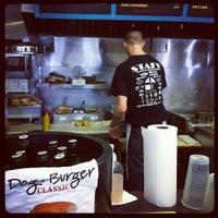Photo taken at Dog-N-Burger Grille by Elizabeth on 3/19/2012
