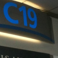 Photo taken at Gate C19 by Joel H. on 8/1/2011