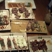Photo taken at Zakkushi Charcoal Grill by Lily T. on 9/12/2011