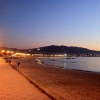 Photo taken at Praia de Samil by Manuel P. on 1/10/2012