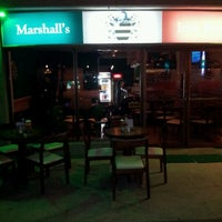 Photo taken at Marshall's Irish Pub by Marshalls I. on 8/2/2012
