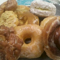 Photo taken at Sunrise Donuts and Sweets LLC by Holli C. on 10/20/2011