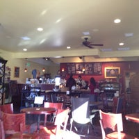 Photo taken at Kunjani Coffea by Brad J. on 3/31/2012